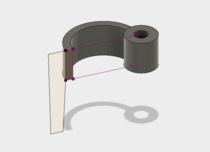 After extruding the first sketch, I created a drawing for the stand at the end of the arm.