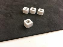Spacers, fresh from the 3d printer, nuts already inserted.
