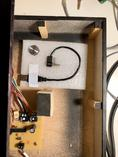 The enclosure now contains a spare power cable and a replacement knob for the rotary encoder.